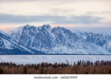 Sunset over Grand Teton National Park during a snowy winter evening