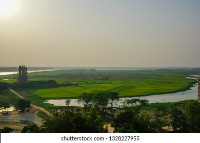 Sunset over the green fields and the river Ganges. Mayapur, India