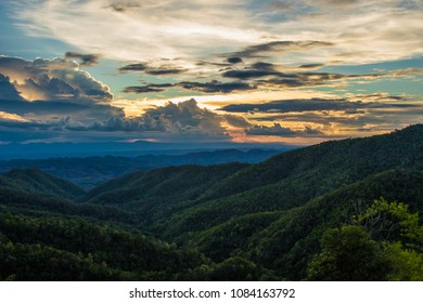 Sunset over green mountains of Northern Thailand