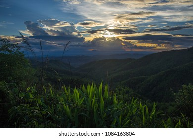 Sunset over green mountains in Northern Thailand