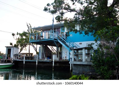 Sunset over the Gulf of Mexico, A Boathouse along the Gulf of Mexico, A Boat in the Gulf of Mexico and reflection, A building along the Gulf of Mexico and reflection