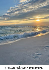 Sunset over the Gulf of Mexico Florida with footprints in the sand