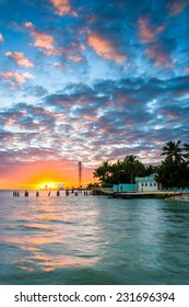 Sunset over the Gulf of Mexico from the Southernmost Point in Key West, Florida.
