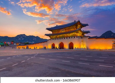 "Sunset over Gwanghwamun gate, Seoul, South Korea. ( Sign board text is "" Gwanghwamun gate"")"