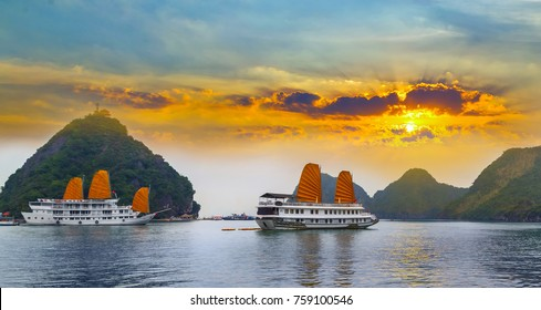 Sunset over Ha Long bay islands Halong mountains in South China Sea, Vietnam. UNESCO World Heritage Site Asia.