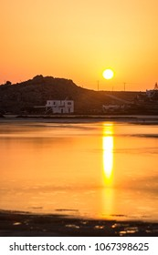 Sunset over Habitations and Calm Sea Water in Naxos, Greece