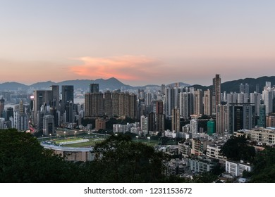 Sunset over Happy Valley district, famous for its horse racecourse  in Hong Kong island, Hong Kong SAR in China
