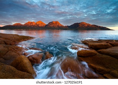 Sunset over the Hazards Freycinet National Park from Coles Bay with Alpine Glow, Tasmania, Australia