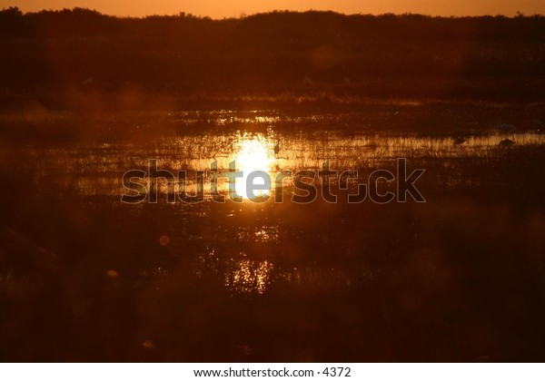 sunset over hills and marshes