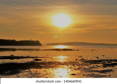 Sunset over Horsens Fjord and  a small island in Denmark