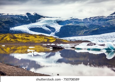 The sunset over the  Iceland's largest glacier Vatnajokull. The concept of extreme northern tourism. Glacier meltwater form a picturesque lake