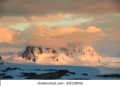 Sunset over icy mountains in Antarctica