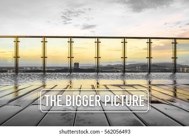 Sunset over an infinity swimming pool with word THE BIGGER PICTURE