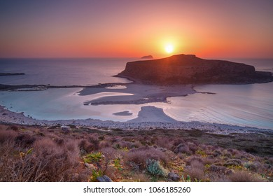 Sunset over island Gramvousa and the Balos beach in Crete, Greece.