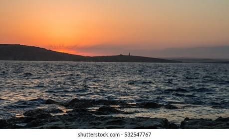 Sunset over the island of St. Paul. Malta. June 2016