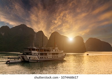 Sunset over the islands of Halong Bay in Vietnam. Amazing landscape background