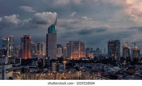 Sunset over Jakarta city downtown