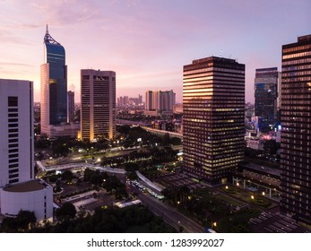 Sunset over Jakarta financial district along the Sudirman avenue in the heart of Jakarta, the largest city in Southeast Asia.