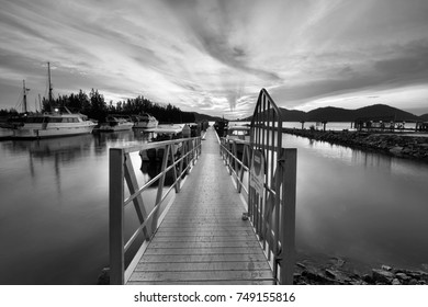 Sunset over the jetty in Marina Island. Black and white photography
