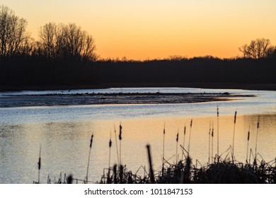 sunset over the Kalamazoo River, Albion, Michigan