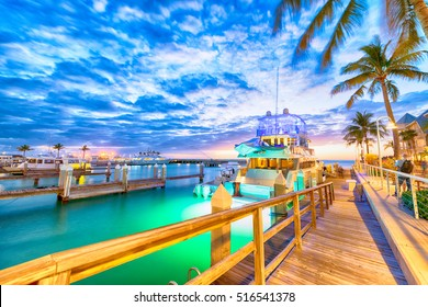 Sunset over Key West, Florida. Wooden bridge at the port.