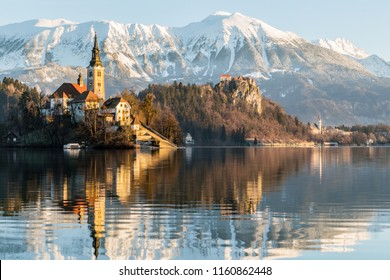 Sunset over Lake Bled with Bled Castle and Mountains in the background