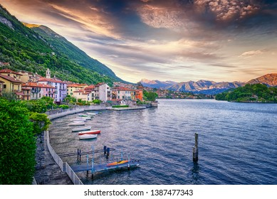 Sunset Over Lake Como Harbour and Italian Village By The Shore.