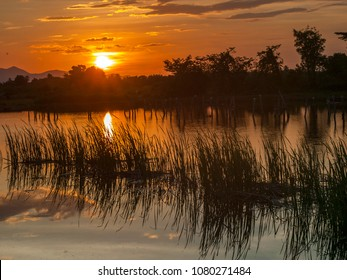 Sunset over a lake in the countryside of rural Thailand