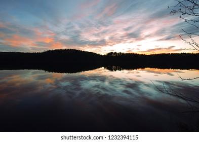 Sunset over a lake in Dalarna in Sweden