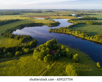 Sunset over the lake in the field. Aerial view over the lakes in Lithuania