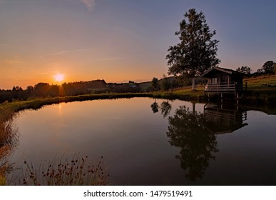 Sunset over a lake in Lower Bavaria, Bavaria, Germany