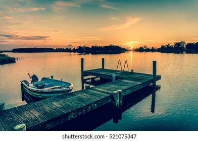 Sunset over a lake in the Netherlands - retro style