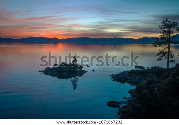 Sunset over Lake Tahoe with island outcropping