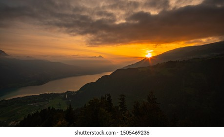 Sunset over lake Thun in the Swiss alps. View from Harder Kulm with Clouds in the sky
