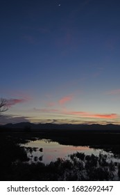 Sunset over landscape with pond