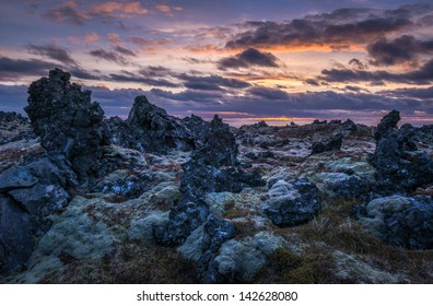 Sunset over a lava field on the Icelandic coast