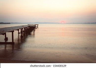 Sunset over lonely pier