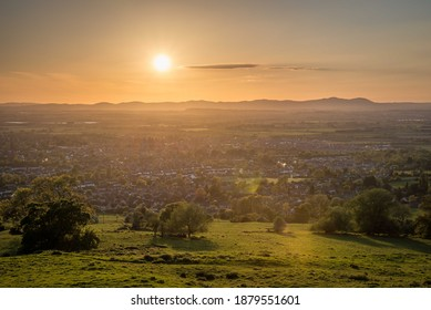 Sunset over the Malvern Hills from Cleeve Hill with views of Cheltenham