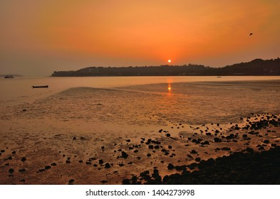 Sunset over Mandovi river in Goa.