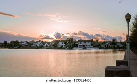 Sunset over man-made lake in Elk Grove California
