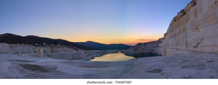 Sunset over the marble lake in middle  of abandoned marble quarry located in Macedonia