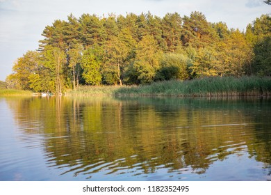 Sunset over Masuria Lake District, Poland, late summer on a sunny day. Landscape.