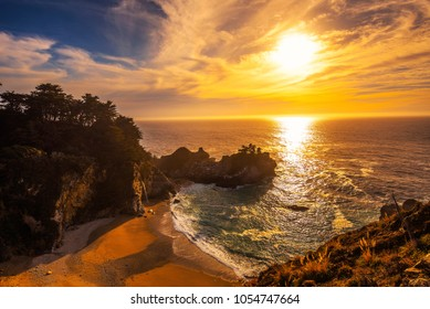 Sunset over McWay Falls on Pacific Coast Highway, Big Sur state park, California.