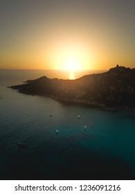 Sunset over the Mediterranean Sea at Plage de Roccapina, a small cove on the coastline of Corsica