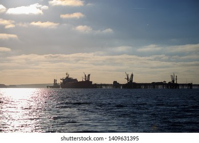 Sunset over Milford Haven oil jettys