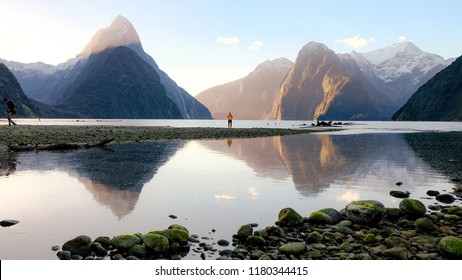 Sunset over Milford Sound on a calm and clear day.