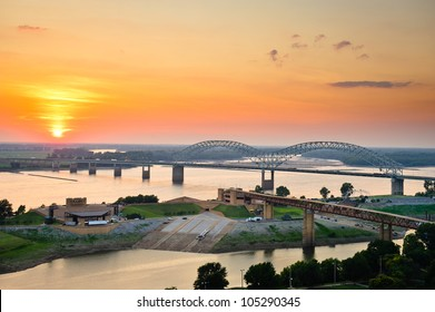 Sunset over the Mississippi River, Hernando de Soto Bridge, and Mud Island River Park in Memphis, Tennessee, USA.