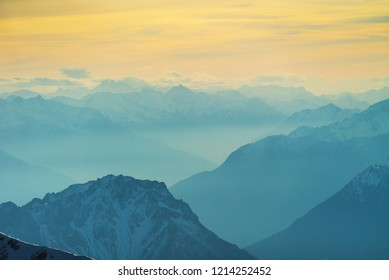 Sunset over misty alpine peaks