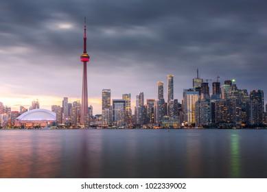 Sunset over modern buildings in Toronto city skyline in Ontario, Canada