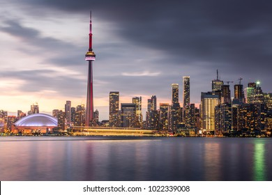 Sunset over modern buildings in Toronto city skyline in Ontario, Canada